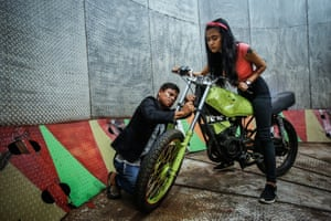Purba and her mentor Tora Palevi check her motorbike before the show