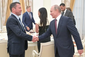 Lothar Matthäus shakes hands with Russia's president Vladimir Putin during a meeting with former players at the Kremlin.