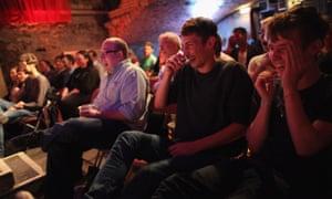 An audience enjoys a live comedy show at the Edinburgh festival.