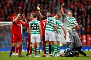 Dominic Ball is shown a red card as Ryan Christie lies motionless on teh floor.