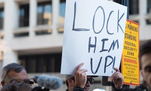A protester holds up a sign after Michael Flynn arrived at the US federal court in Washington DC on Friday.