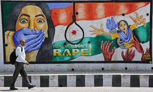 A man walks past a graffiti depicting a message in protest against rape, in Jammu, on 22 April