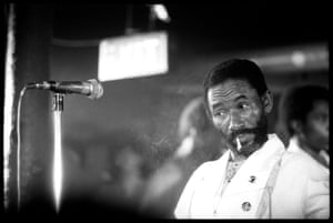 Lee 'Scratch' Perry smokes a joint on stage at Dingwalls, London in January 1984.