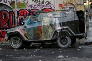 Santiago, Chile A vandalised riot police vehicle during a protest against the government