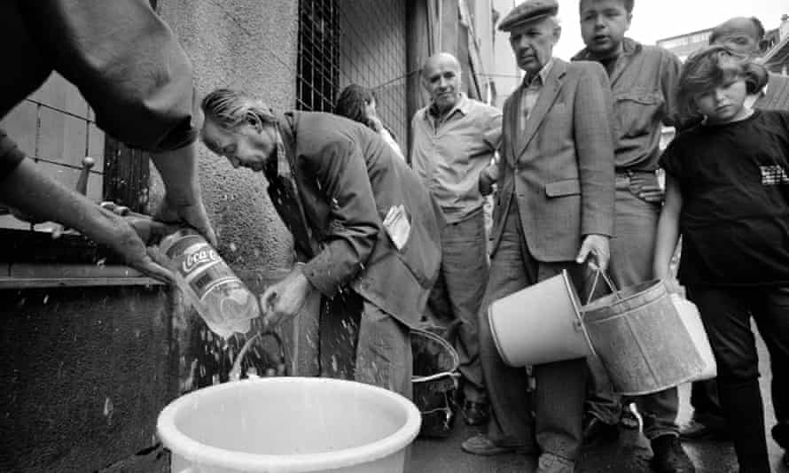 Residents collecting water in buckets and bottles from a standpipe on a Sarajevo street in 1992. The siege of the city was Europe's longest since the end of the second world war.
