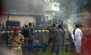 Pakistan army officials visit the site of a plane crash an Rawalpindi.