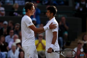 Novak Djokovic is consoled by Tomas Berdych as he retires injured.