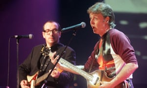 Sneer and smile … Costello and Paul McCartney on stage together in 1999.