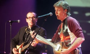 Costello with Paul McCartney in 1999.