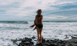 woman contemplates a swim