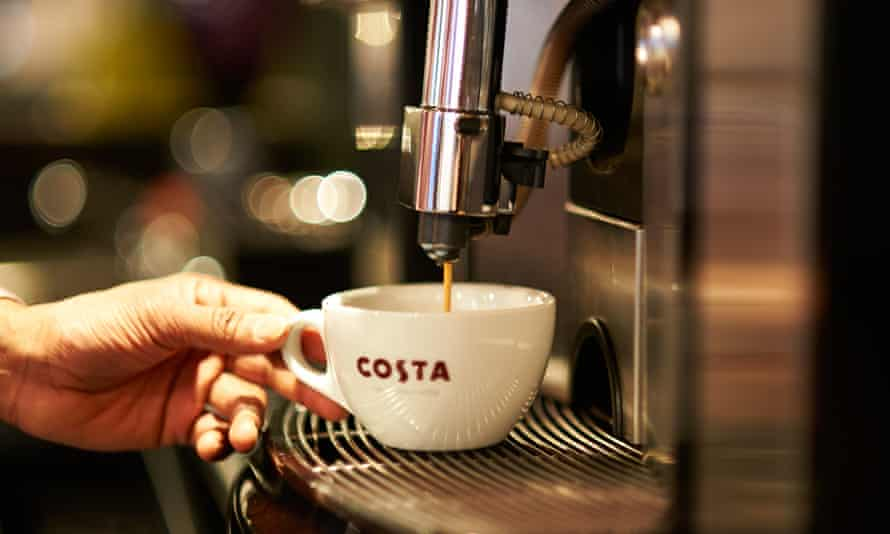A coffee being poured at Costa Coffee