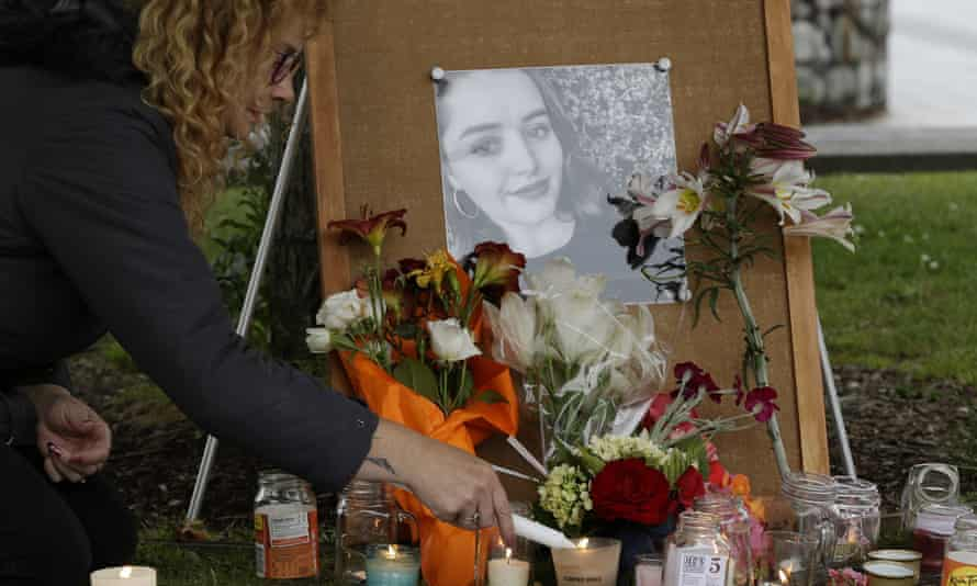 A woman lights candles during a vigil for Grace Millane in Christchurch, New Zealand.