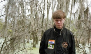 Dylann Roof, who is accused of killing people in a shooting in Charleston on Wednesday night, pictured wearing a coat with apartheid-era badges.