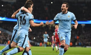 Frank Lampard celebrates with his teammates during his season playing at Manchester City.