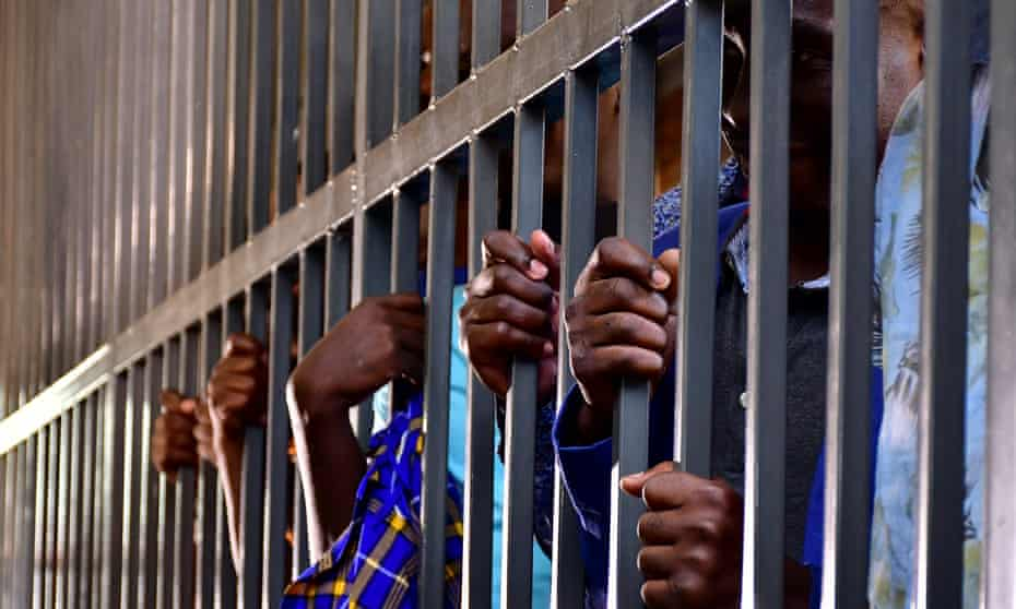 Ugandan opposition activists stand in the dock a court in Makindye, a suburb of Kampala, on 17 May