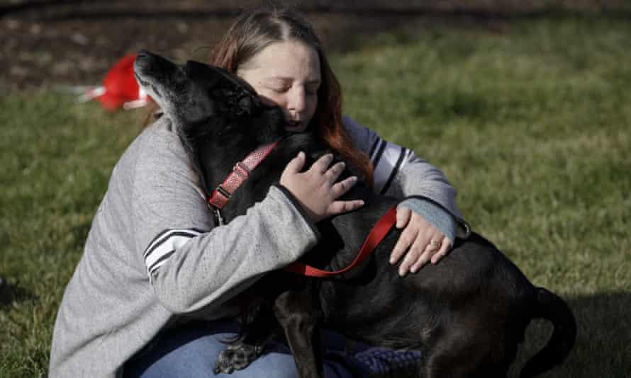 Debra Mejeur hugs her dog, Lola, Saturday in Wheaton, Illinois.