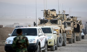 Armored vehicles of the US army move toward Mosul from the Hazer region during an operation to retake the city from Isis.