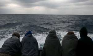 Migrants are seen aboard a rescue vessel in Mediterranean