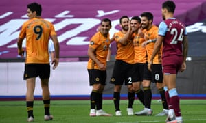 Pedro Neto of Wolverhampton Wanderers celebrates with teammates after scoring.