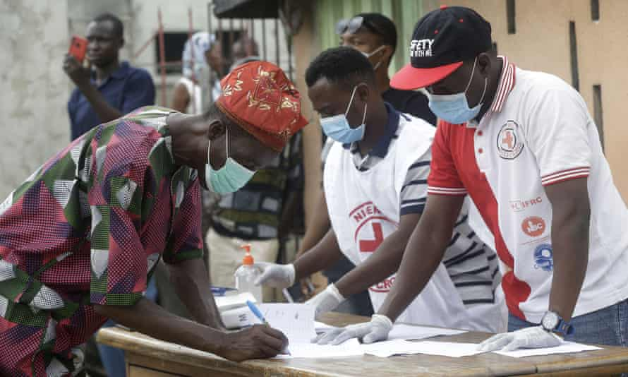 A Lagos resident registers with the Red Cross before receiving food aid.