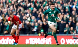 Jacob Stockdale scores Ireland's fifth try during their victory against Wales