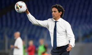 Lazio's coach, Simone Inzaghi, returns the ball during Saturday's defeat by Milan. He is refusing to give up on the title despite falling seven points behind Juventus.