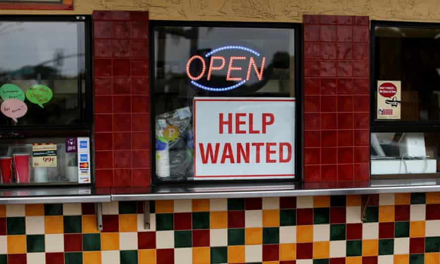 A help wanted sign at a taco stand in Solana Beach, California
