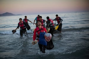 Migrants from Pakistan Walk to shore in Kos, Greece, after rossing a three mile stretch of the Aegean Sea from Turkey in a small dinghy