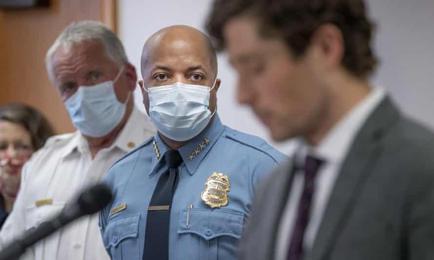 Minneapolis police chief, Medaria Arradondo, center, listens as Minneapolis mayor Jacob Frey becomes emotional during a news conference 28 May.