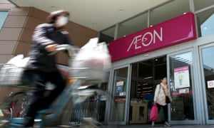 Shoppers leave an Aeon Co. shopping center in Tokyo, Japan.