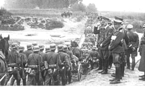 Adolf Hitler observes German troops crossing the Vistula River during the invasion of Poland near Chelmno, northern Poland, September 1939.