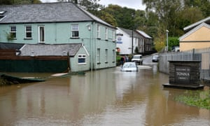 A car is stranded in floodwater in Tonna near Aberdulais.