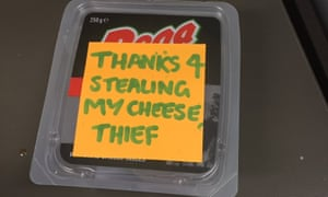 An angry Post-it note on a packet of cheese amid an intra-office communications breakdown.