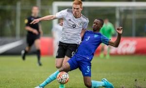 Melayro Bogarde tackles Germany's David Hummel while playing for Netherland Under-15s