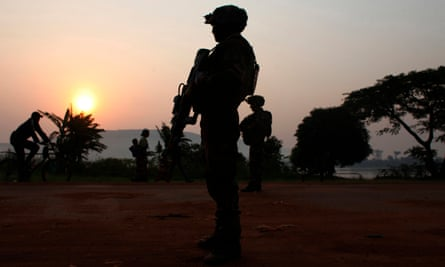 A French soldier takes position at daybreak in the Central African capital, Bangui