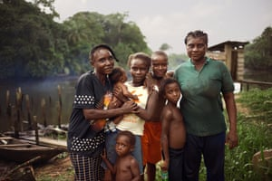 Pelepre Newton, fisher and farmer, with her family, Azuzuama community, Bayelsa, Nigeria, 2018