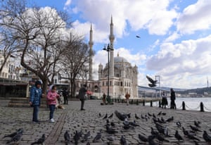 Tourists, exempt from the curfew, are seen around Ortakoy Square and surroundings during a general curfew imposed weekend-long from Friday 9 p.m. to Monday 5 a.m. local time within new measures against a second wave of the coronavirus pandemic, in Istanbul, Turkey on 28 February, 2021.