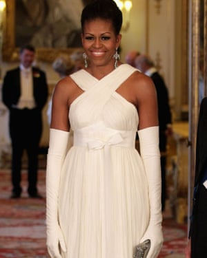 Michelle Obama poses in the music room of Buckingham Palace ahead of a state banquet, London, 24 May 2011.