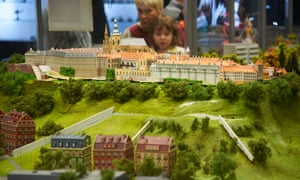 Prague's Kingdom of Railways features model trains running around miniature versions of Czech cities. A mother and her daughter watch one run around Prague castle.