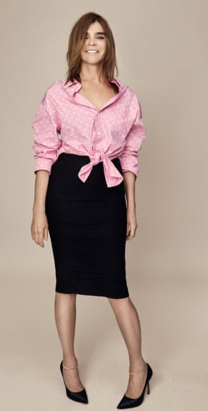 Carine Roitfeld wears shirt by Balenciaga; skirt by Tom Ford; shoes by Manolo Blahnik; ankle bracelets by Venyx.