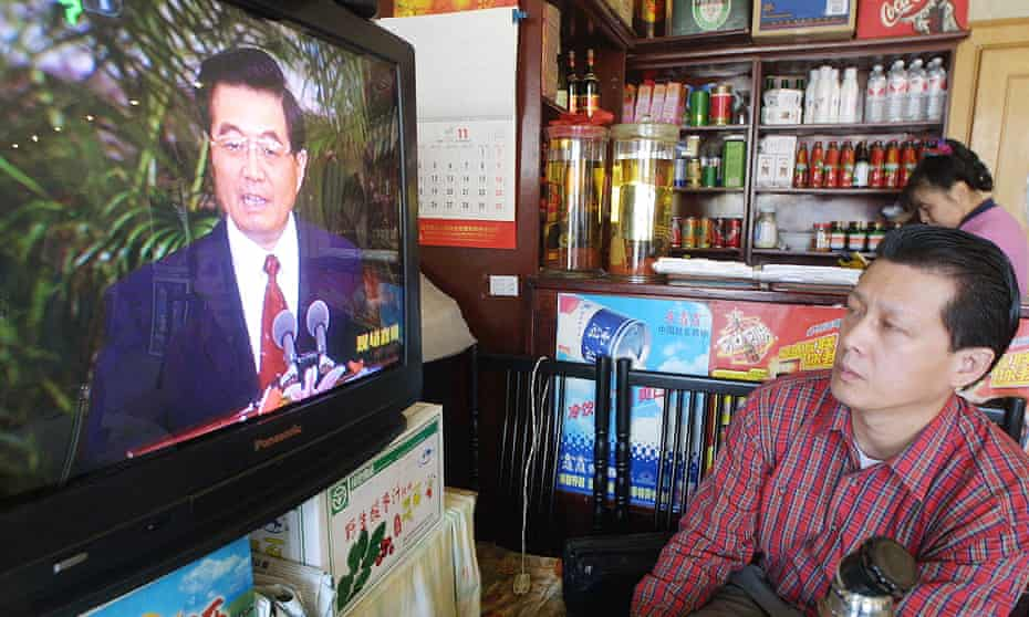 A restaurant owner watches after Hu Jintao was named general secretary of China's Communist party in 2002