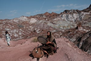 Odin plays daf (a traditional Persian drum) near Rainbow valley - a popular sightseeing spot. Hormoz island. Iran