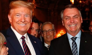 Jair Bolsonaro's communications director Fabio Wajngarten (second left, partially obscured), is seen during a meeting with Donald Trump at Mar-a-Lago in Florida.