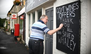 Malcolm Swets, manager of Goyt Wines, writes a thank you note on a board after police said it was safe for people to return.