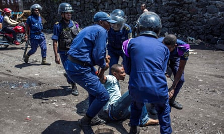 Police arrest a man in Goma during a protest against the postponement of the general election