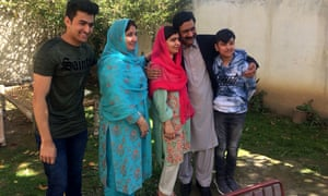Yousafzai with her family members at her native home during a visit to Mingora in 2018.