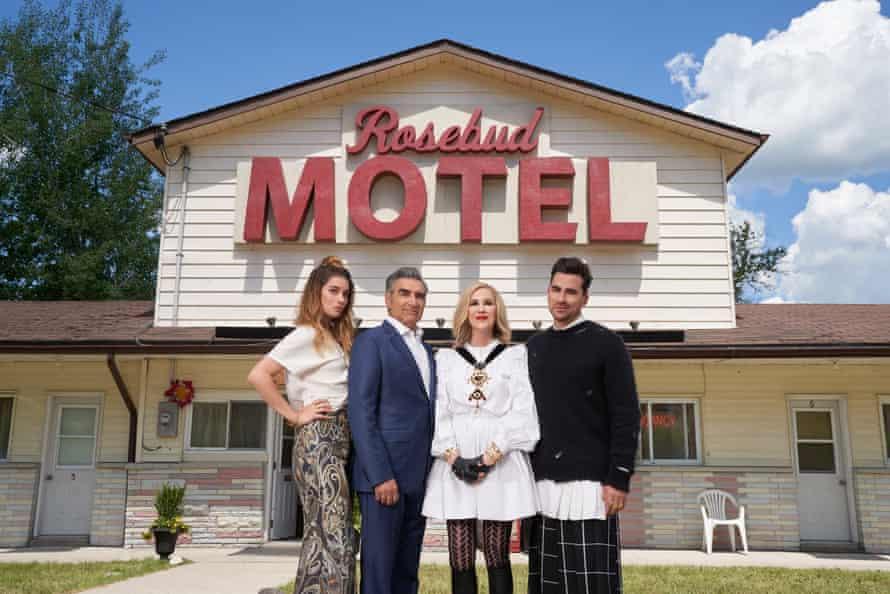 Schitt's Creek's Rose family in front of the Rosebud Motel