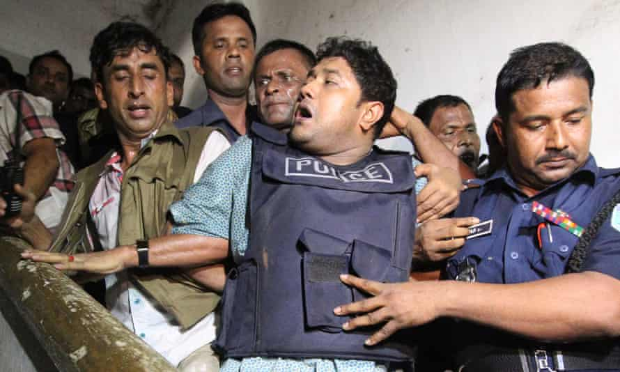 Sohel Rana, wearing a bulletproof vest, is taken by police to the courts in April 2013.