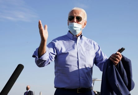 Joe Biden talks to reporters after a day of campaigning in Las Vegas, Nevada, on 9 October.