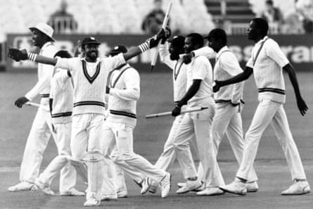 West Indies players celebrate after winning the third Test at Old Trafford.